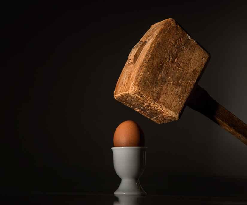 egg-hammer-threaten-violence